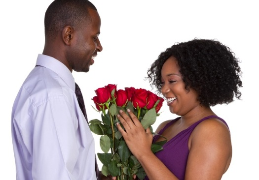 African-american-couple-man-giving-roses-small